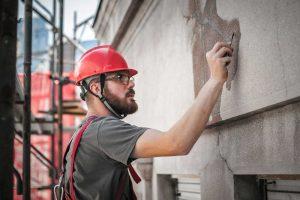 man working on concrete restoration